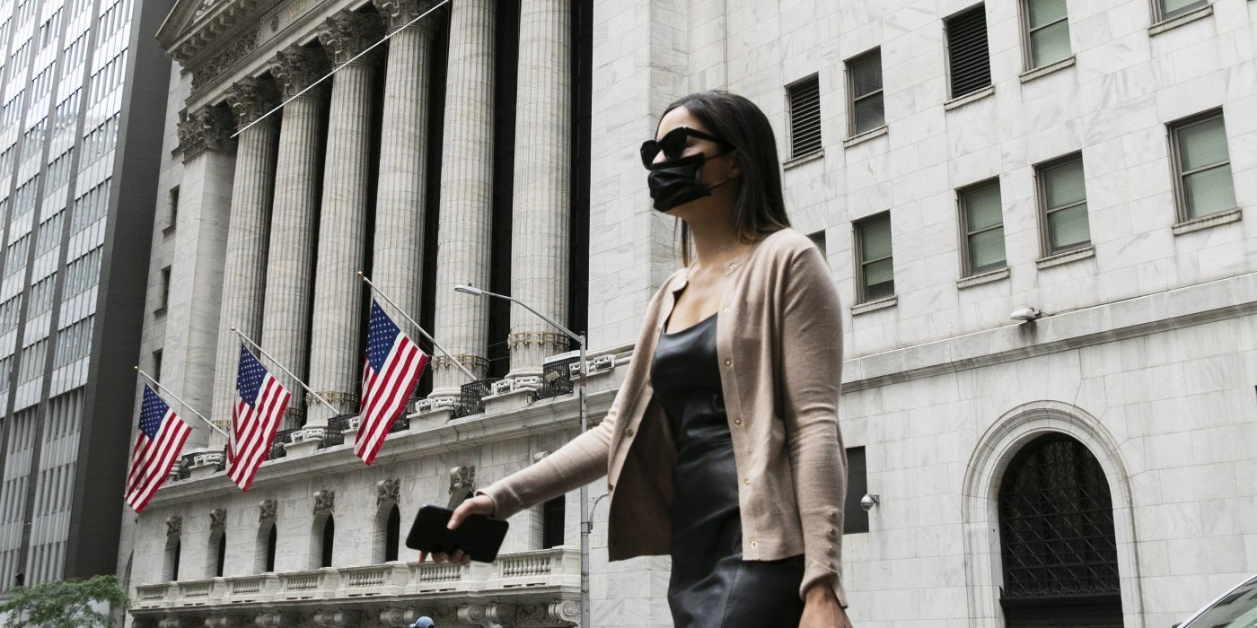 Woman in mask at NY stock exchange
