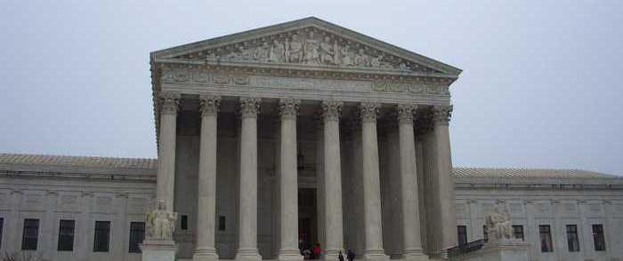 A Dozen States Back Trump's Travel Ban at Supreme Court