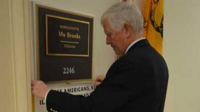Ala. Rep. Mo Brooks Hangs Pro-American Poster to Counter Socialist Dem. Across Hall