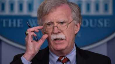 Bolton & Trump Point at China, not Russia, for Election Meddling
