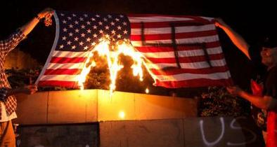 Hondurans Paint Swastika on American Flag and Burn It