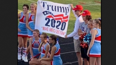 North Carolina High School Places Cheerleading Squad on Probation for Posing w/ Pro-Trump Flag