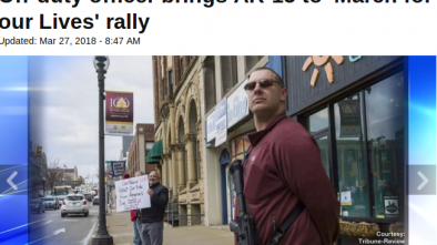 Off Duty Police Officer Carried an AR-15 at a Gun Control Rally