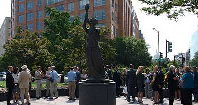 Protesters Make Obscene Gesture at Victims of Communism Memorial