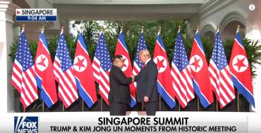 Trump & Kim Share Historic Handshake
